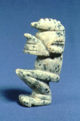 carved seated figure|64