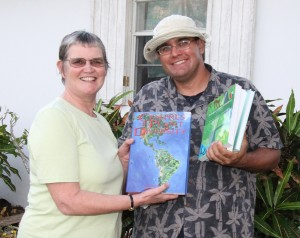 Ann Pienkowski (UKOTCF) gifting books to DEMA, accepting is B. Naqqi Manco)